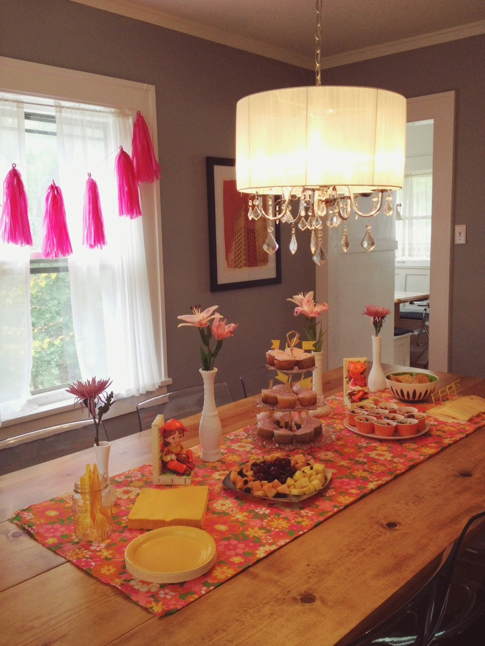 cute feminine baby shower for a girl with vintage touches yellow and pink with milk glass and flowers